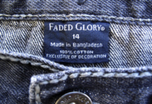 """Figure 1: """"Made in Bangladesh"""" tag inside a jeans of a Walmart brand 'Faded Glory'."""