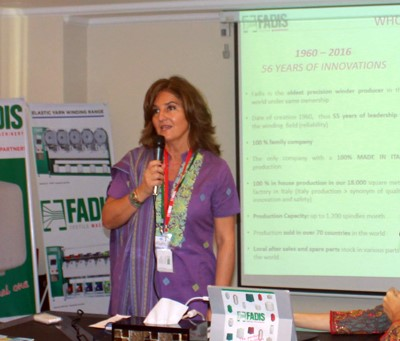 Figure 3: Dr. Raffaella Carabelli is presenting how a winder can help any yarn dyeing project to win
