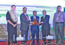 Figure 1: Chief guest of the stakeholder's day Engr. Kutubuddin Ahmed, Chairman, Envoy Group was receiving crest from Faruque Hasan (Sr. Vice President, BGMEA) and Prof. Nizamuddin Ahmed (Vice Chancellor, BUFT).