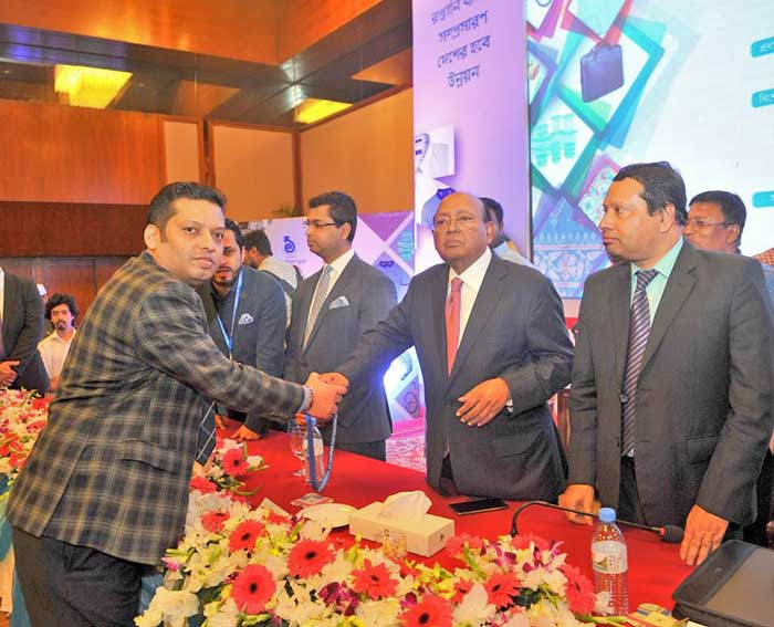 Figure 1: A renowned industry owner took CIP card from Commerce Minister Tofail Ahmed.