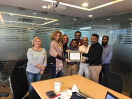 Figure: Fakir Kamruzzaman Nahid, Managing Director of Fakir Fashion Limited takes certificate from ESPRIT team.