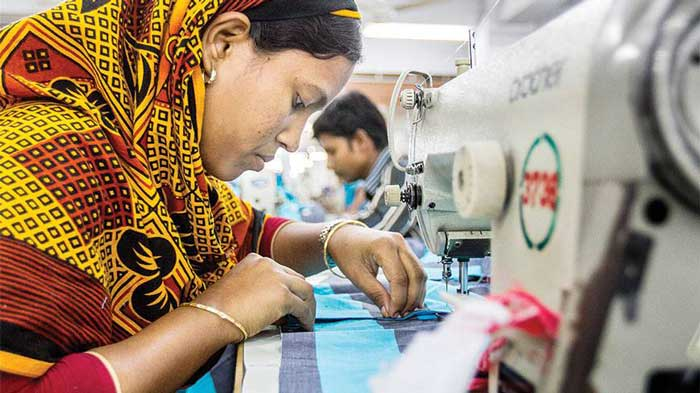 Figure: A female garment worker sewing a garment in the factory.