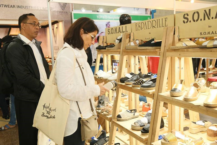 Figure 2: A visitor inspects different types of leather goods at the exhibition.