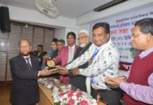 Figure 1: ANM Ahmed Ullah is receiving the award form chief guest Md. Siddiqur Rahman Mia, Magistrate, Appeal Department of Bangladesh Supreme Court.