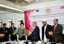Figure: FBCCI president, Shafiul Islam Mohiuddin handed over a crest to Ms. Zou Xia, Director of CCPIT (Shandong) led the Chinese delegation. Representatives from BEZA, BIDA, BEPZA were also present at the meeting.