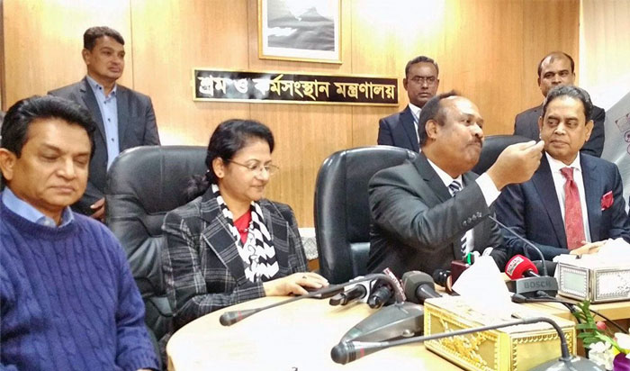 Figure 1: State Minister for Labour and Employment Mujibul Haque Chunnu, centre, announces formation of a new wage board for readymade garments workers at his ministry conference room on Sunday, December 18, 2018.