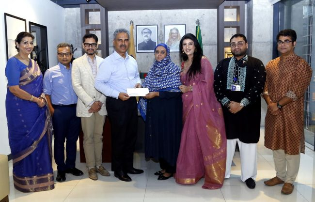 BGMEA President Faruque Hassan handed over a cheque of Taka 5 lacs to the wife of Chanchal Mahmood.